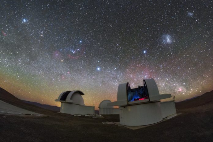 The telescopes of the SPECULOOS Southern Observatory gaze out into the stunning night sky over the Atacama Desert, Chile. Credit: ESO/ P. Horálek