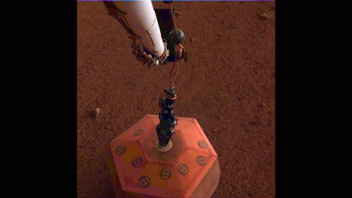 NASA's InSight lander placed its seismometer on Mars on Dec. 19, 2018. This was the first time a seismometer had ever been placed onto the surface of another planet. Credits: NASA/JPL-Caltech