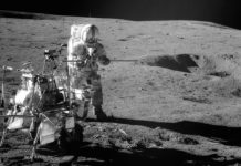 Apollo 14 Astronaut Alan B. Shepard Jr. assembles equipment on the lunar surface in Feburary 1971. Credit: NASA