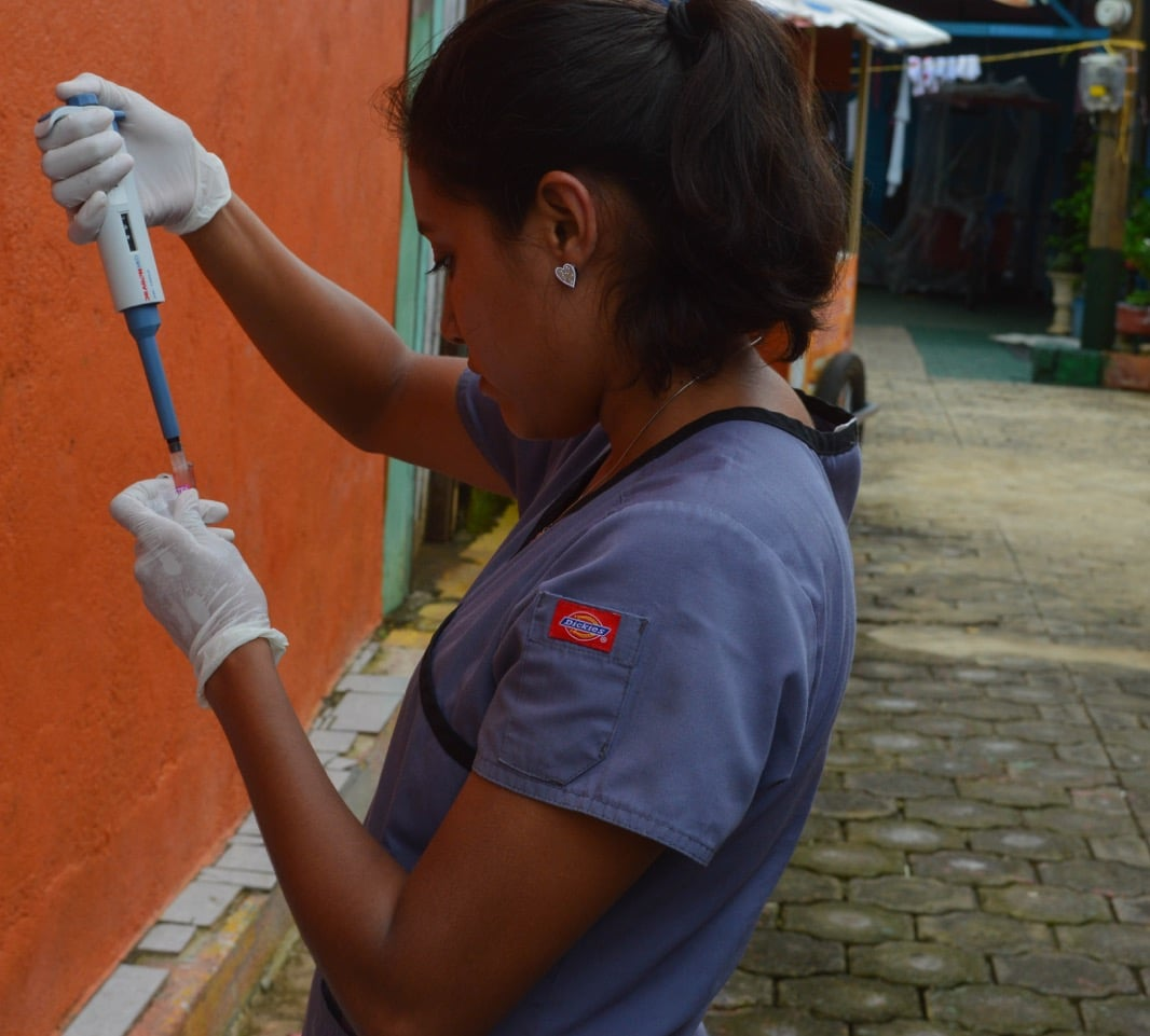 Study team member Ingrid Massiel Mercado processes a blood sample in a neighborhood in Managua in June 2017 as part of the Nicaraguan Pediatric Dengue Cohort Study (PDCS), a long-standing pediatric dengue cohort established in 2004. Image credit: Sustainable Sciences Institute, Paolo Harris Paz.