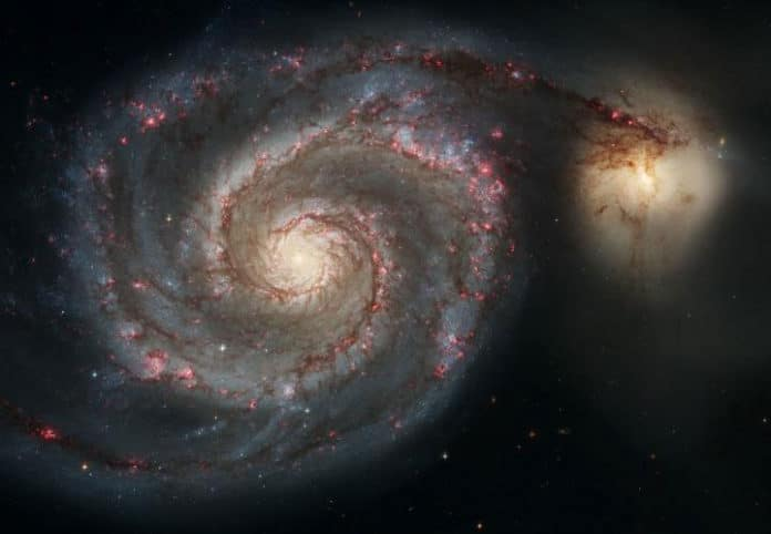 The Whirlpool Galaxy (M51a) and companion galaxy (M51b). This Hubble Space Telescope image represents a merger between two galaxies similar in mass to the Milky Way and the Large Magellanic Cloud. CREDIT NASA, ESA, S. Beckwith (STScI), and The Hubble Heritage Team (STScI/AURA)