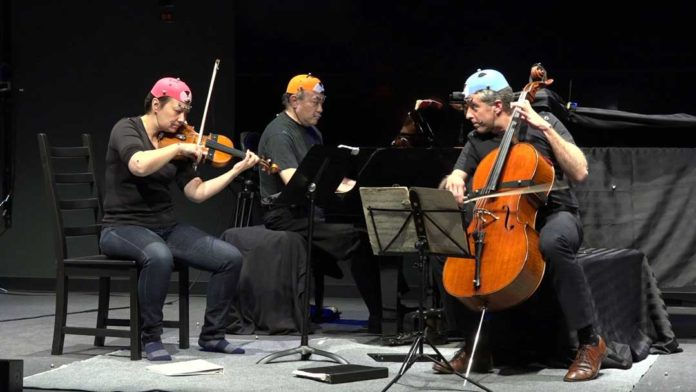 Members of the Gryphon Trio perform while scientists measure their movements. Credit: LIVELab, McMaster University
