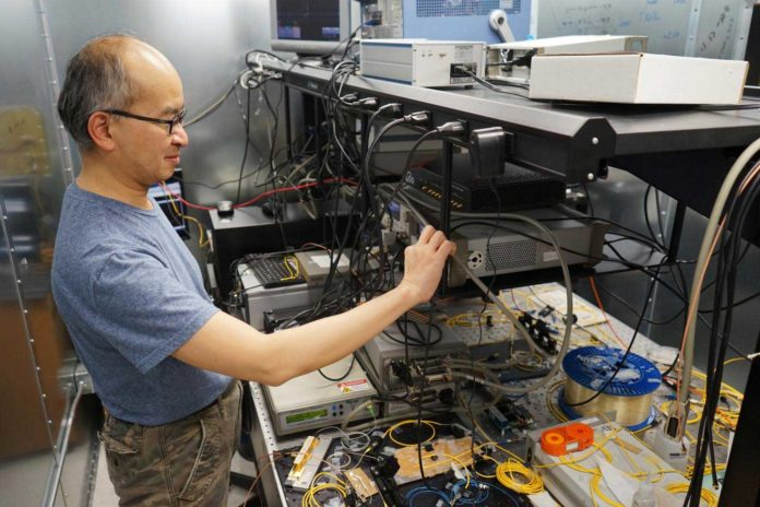 Professor Hoi-Kwong Lo (ECE) and his collaborators have performed a proof-of-principle experiment on a key aspect of all-photonic quantum repeaters. CREDIT Jessica MacInnis
