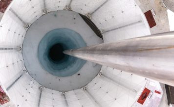 Researchers used a hot-water drill to bore through a kilometre of ice, creating a portal with a diameter of just 60 centimetres. Credit: Billy Collins/SALSA Science Team
