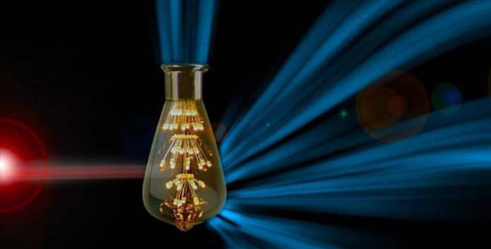 Billions of molecular lightbulbs, powered by invisible infrared photons, generate visible light. Credit: Melissa Ann Ashley