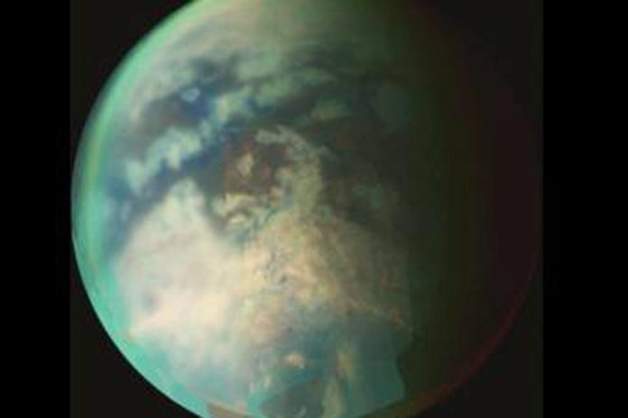 New research provides evidence of rainfall on the north pole of Titan, the largest of Saturn's moons, shown here. The rainfall would be the first indication of the start of a summer season in the moon's northern hemisphere, according to the researchers. Credit: NASA/JPL/University of Arizona.