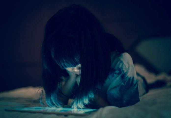 Screen time before bed puts children at risk of anxiety, obesity and poor sleep