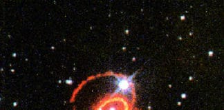 This image, taken with Hubble's Wide Field and Planetary Camera 2in 1995, shows the orange-red rings surrounding Supernova 1987A in the Large Magellanic Cloud. The glowing debris of the supernova explosion, which occurred in February 1987, is at the center of the inner ring. The small white square indicates the location of the STIS aperture used for the new far-ultraviolet observation.