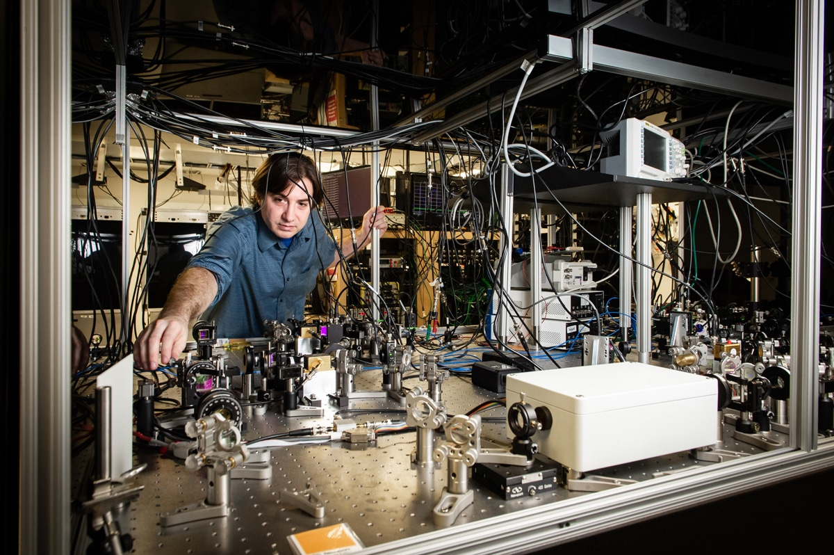 Thomas Corbitt in his lab, setting up a complex sequence of lasers.Elsa Hahne/LSU