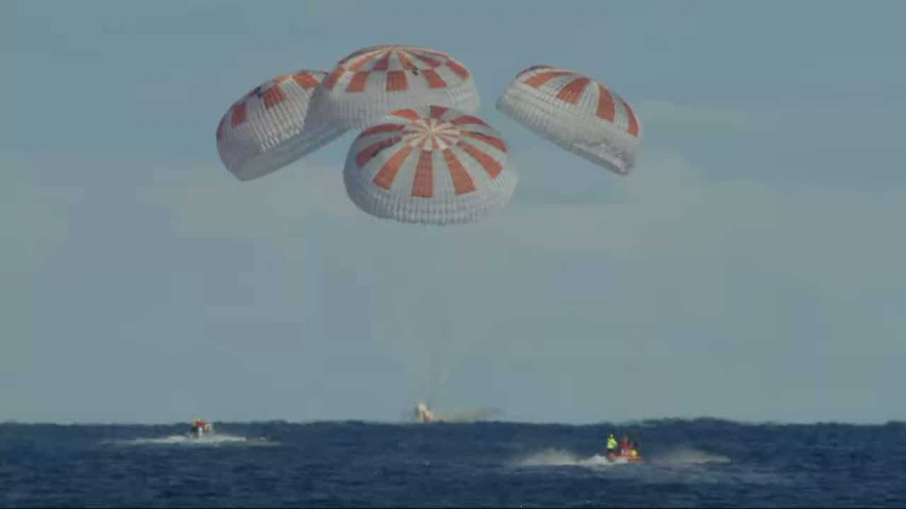 The SpaceX Crew Dragon splashes down in the Atlantic Ocean about 200 miles off Florida's east coast at 8:45 a.m. EST Friday