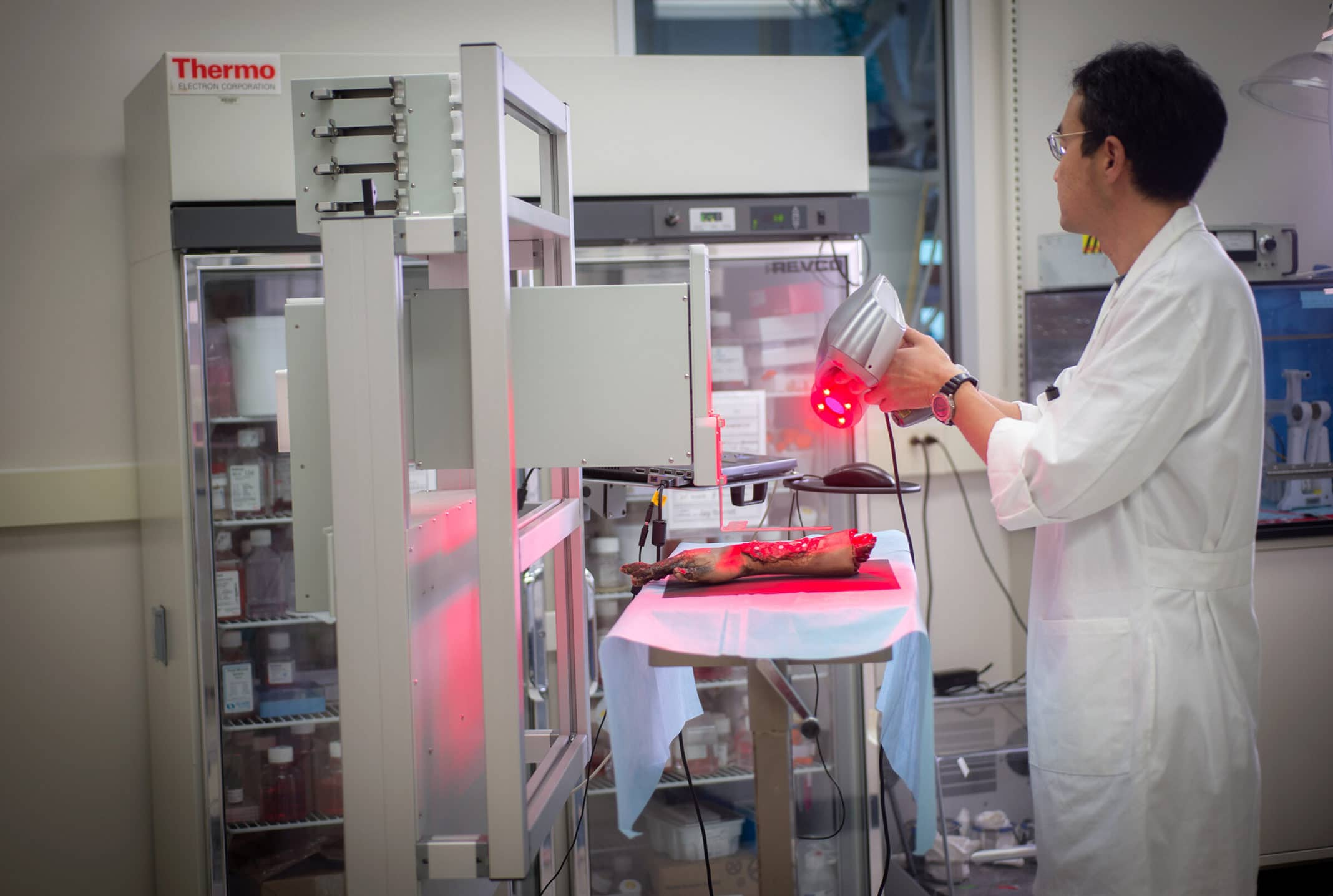 A WFIRM technician operates the mobile bio printer for skin printing on a limb demo. Credit: WFIRM