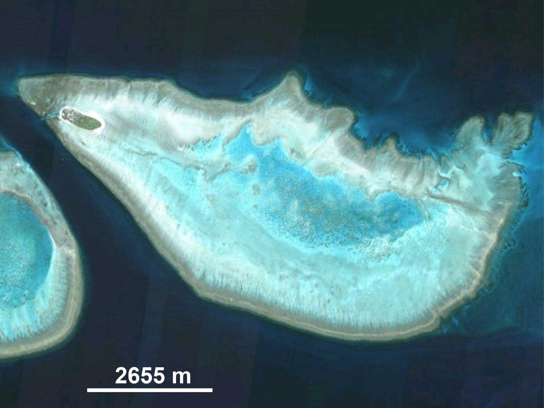 Heron Island (dark green oval in upper left corner) and lagoon, Australia. CREDIT Copyright: DigitalGlobe.