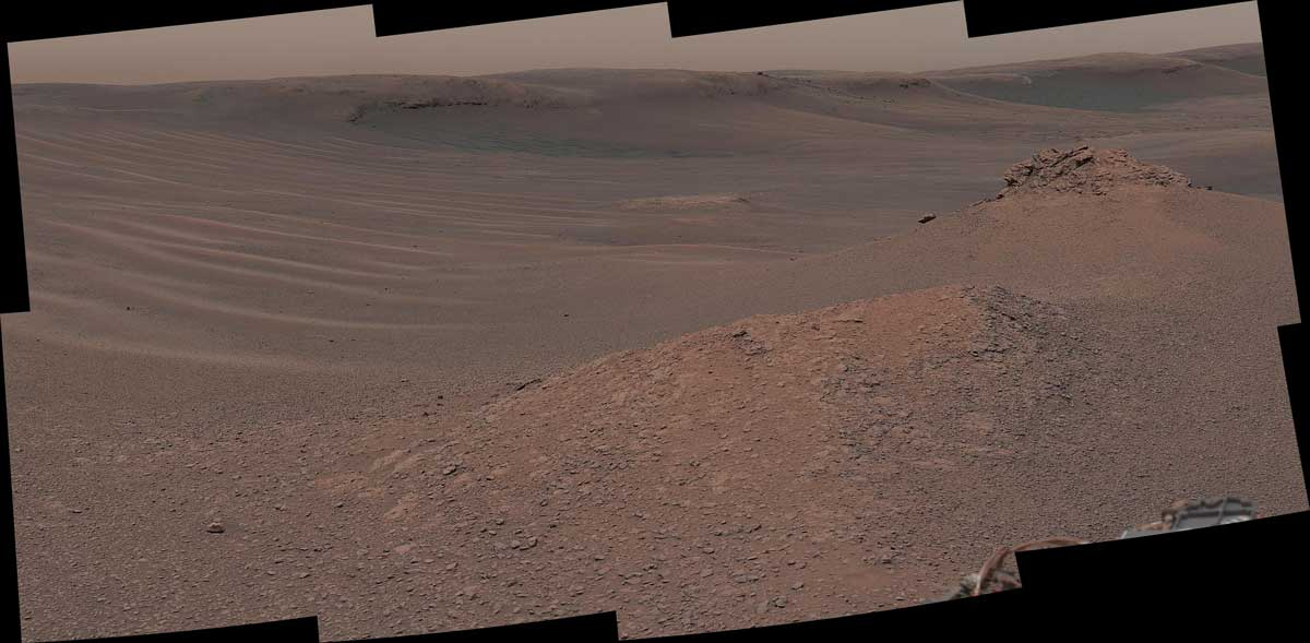 "The Mast Camera (Mastcam) on NASA's Curiosity Mars rover captured this mosaic as it explored the clay-bearing unit on February 3, 2019 (Sol 2309). This landscape includes the rocky landmark nicknamed ""Knockfarril Hill"" (center right) and the edge of Vera Rubin Ridge, which runs along the top of the scene.Credit: NASA/JPL-Caltech/MSSS"