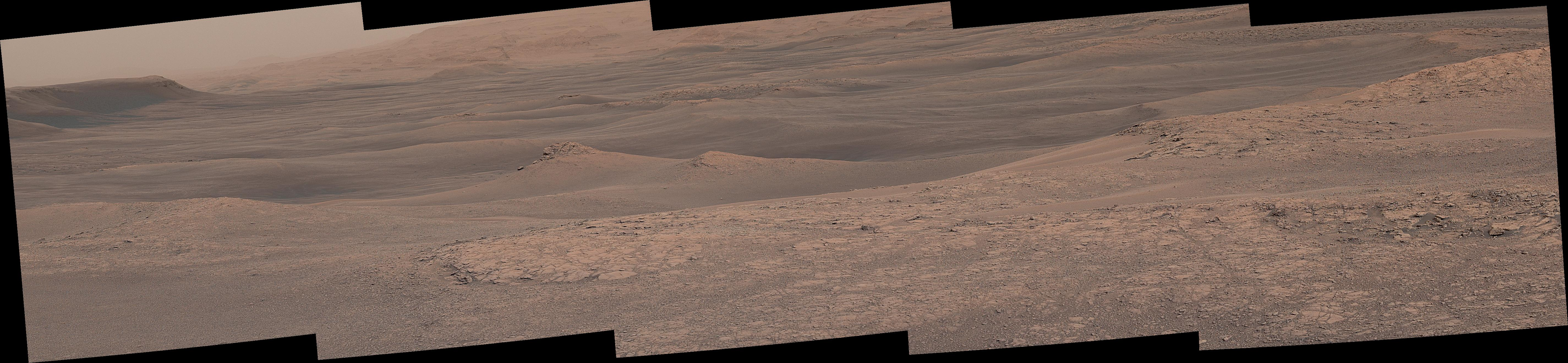 The hills and troughs in this little valley, carved between a ridge and cliffs higher up Mount Sharp, almost look like undulating waves. The Mast Camera (Mastcam) on NASA's Curiosity Mars rover captured this mosaic as it explored the clay-bearing unit on Jan. 23, 2019 (Sol 2299). Credit: NASA/JPL-Caltech/MSSS