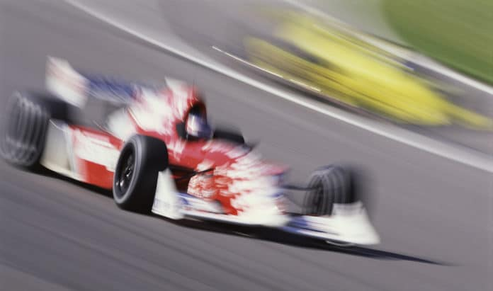 Racing Car in Motion --- Image by © Royalty-Free/Corbis