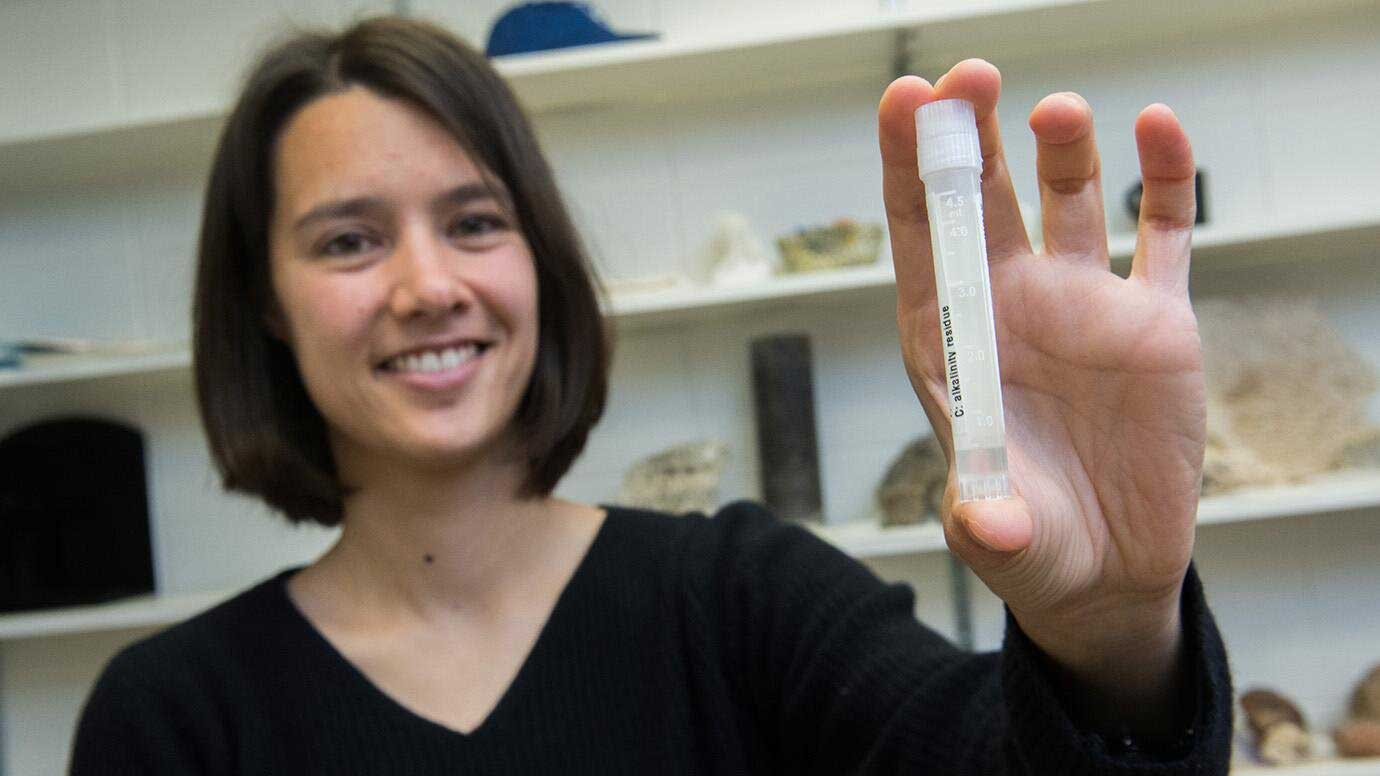 Assistant Professor Clara Blättler with a vial of seawater dating to the last Ice Age—about 20,000 years ago. Credit: Jean Lachat