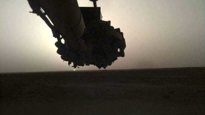 NASA's InSight lander used its Instrument Deployment Camera (IDC) on the spacecraft's robotic arm to image this sunrise on Mars on April 24, 2019, the 145th Martian day (or sol) of the mission. This was taken around 5:30 a.m. Mars local time.