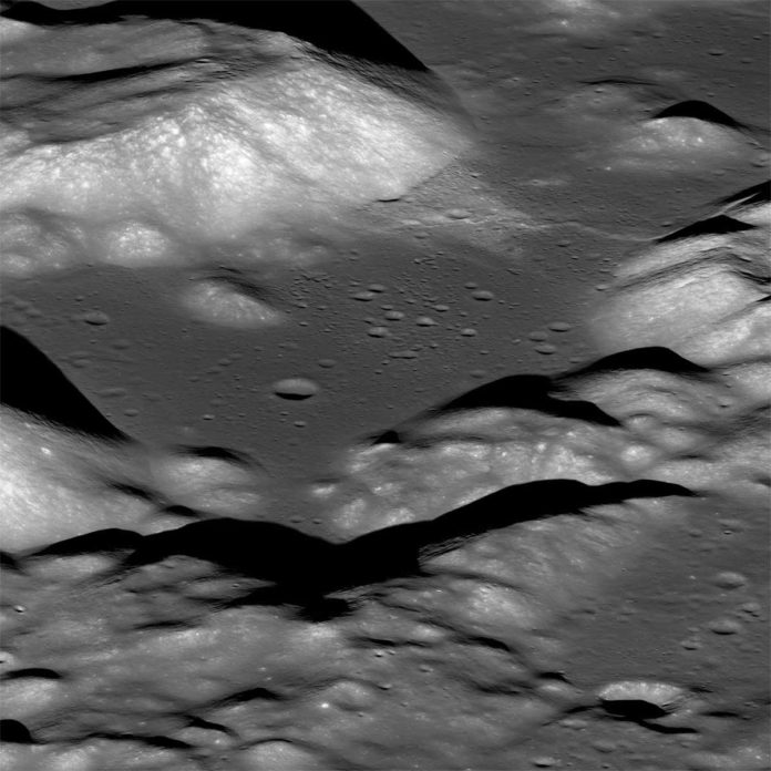 This is a view of the Taurus-Littrow valley taken by NASA's Lunar Reconnaissance Orbiter spacecraft. The valley was explored in 1972 by the Apollo 17 mission astronauts Eugene Cernan and Harrison Schmitt. They had to zig-zag their lunar rover up and over the cliff face of the Lee-Lincoln fault scarp that cuts across this valley. Credits: [NASA/GSFC/Arizona State University