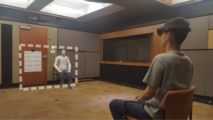 "The photo shows an actor in place of a research participant and what they experienced during one of the studies. The area inside the dotted line is the field of view of the augmented reality goggles, which shows digital content such as an avatar, ""Chris."" (Image credit: Mark Miller and Stanford's Virtual Human Interaction Lab)"