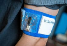 Prototype of the cooling and heating patch embedded in a mesh armband. Photos by David Baillot/UC San Diego Jacobs School of Engineering