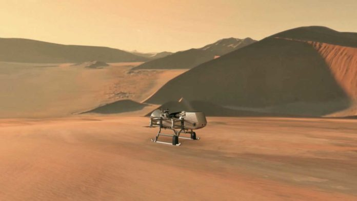 This illustration shows NASA's Dragonfly rotorcraft-lander approaching a site on Saturn's exotic moon, Titan. Taking advantage of Titan's dense atmosphere and low gravity, Dragonfly will explore dozens of locations across the icy world, sampling and measuring the compositions of Titan's organic surface materials to characterize the habitability of Titan's environment and investigate the progression of prebiotic chemistry. Credits: NASA/JHU APL