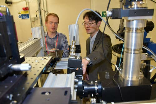 Dr Peter Martin (University of Bristol) and Dr Yukihiko Satou (Japan Atomic Energy Agency) at the Diamond Light Source facilities. University of Bristol/Diamond Light Source