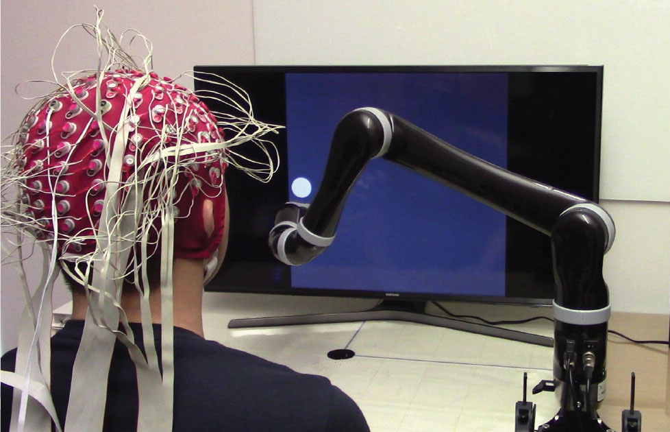 First-ever noninvasive mind-controlled robotic arm/ Image : CMU