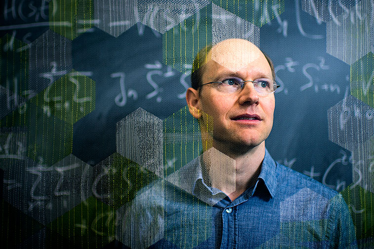 Lasers can be used to change the arrangement of electrons within a material, says physics professor Gregory Fiete. But predicting that change is complicated. Photo by Matthew Modoono/Northeastern University