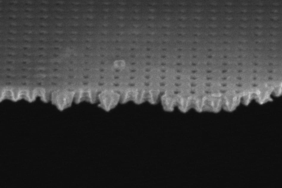 A scanning electron microscope image shows the thin membrane used in these experiments, with holes just 100 nanometers across. The membrane was used to both heat the liquid and measure its temperature upon evaporation.  Image courtesy of the researchers
