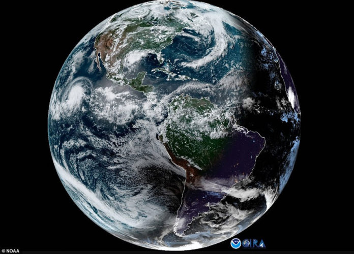 Satellite captured Solar Eclipse and Hurricane Barbara at the same time