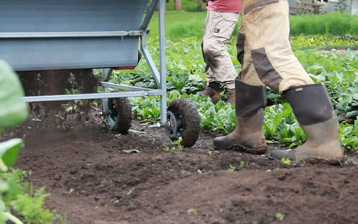 Nu-tan soil supplement spreader in action, image supplied by Design Factory Melbourne