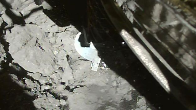 This picture from JAXA shows Hayabusa-2 making contact with the asteroid's surface. AFP