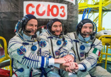 At the Baikonur Cosmodrome in Kazakhstan, Expedition 60 crew members Drew Morgan of NASA, Alexander Skvortsov of the Russian space agency Roscosmos and Luca Parmitano of ESA (European Space Agency) pose for pictures July 5, 2019, in front of their Soyuz MS-13 spacecraft during prelaunch preparations. They will launch July 20, 2019 from Baikonur for their mission on the International Space Station. Credits: Roscosmos/Andrey Shelepin
