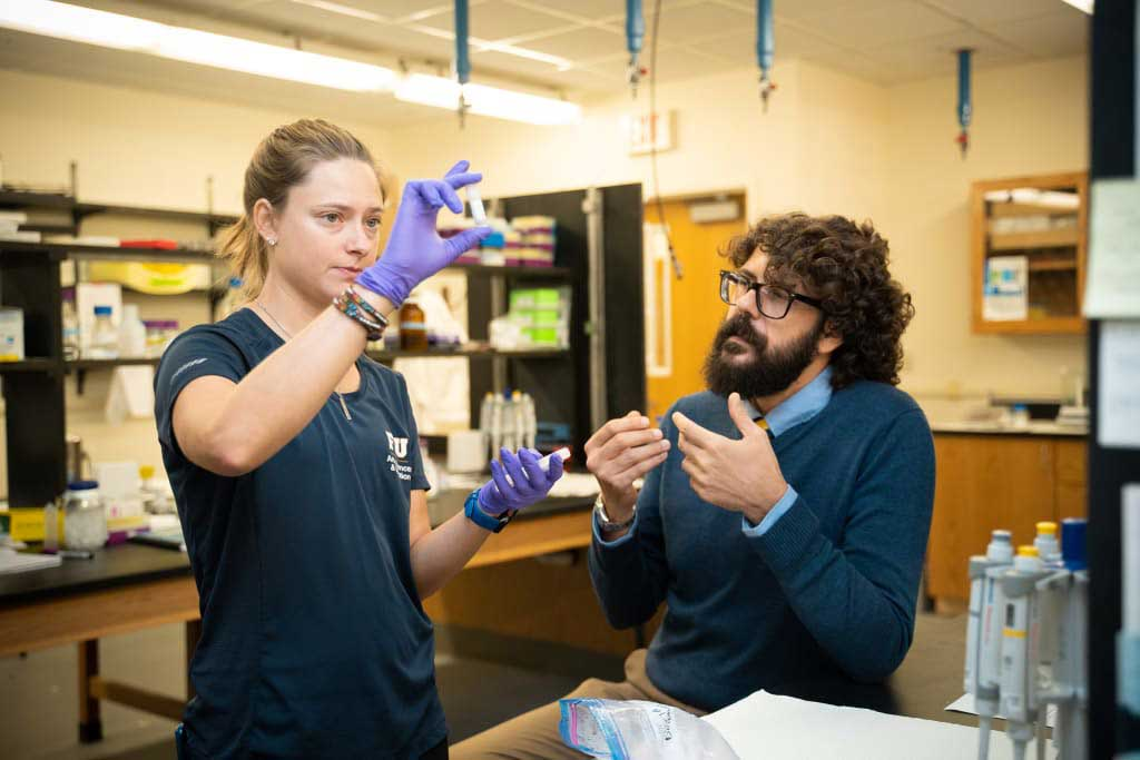 FIU Ph.D. student Andria Beal and researcher Jose Eirin-Lopez in FIU's Environmental Epigenetics Lab.