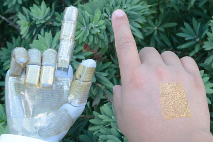 Researchers reported the discovery of a multifunctional ultra-thin wearable electronic device that is imperceptible to the wearer. It also can be used as a robotic skin. Image Credit: University of Houston