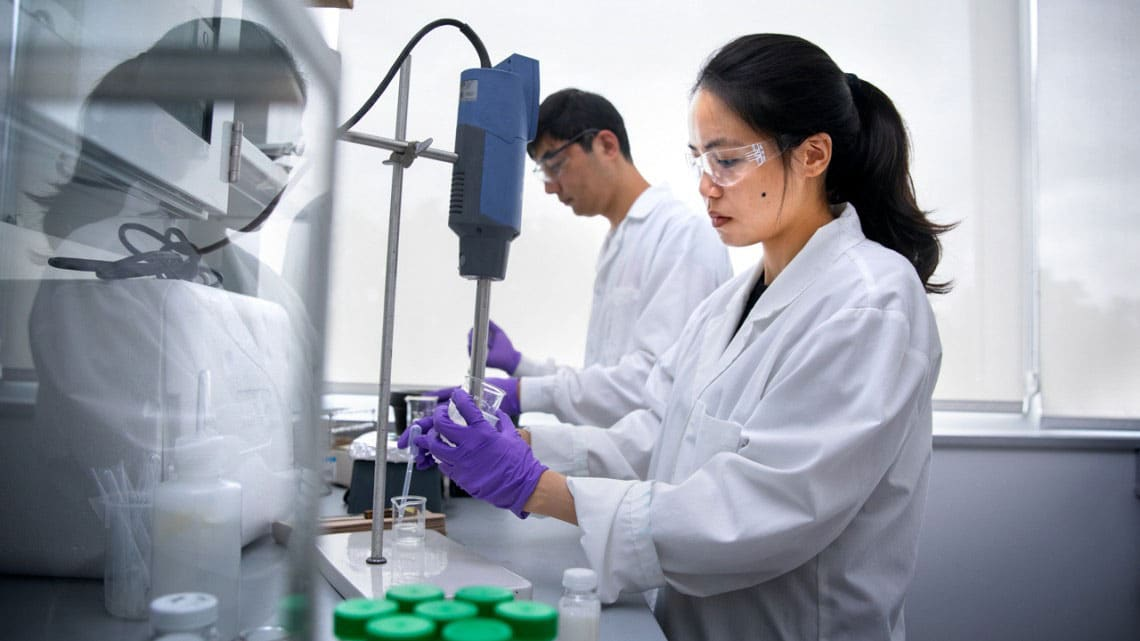Doctoral candidate Michelle Lee, foreground, and postdoctoral researcher Chen Tan work in the laboratory of Alireza Abbaspourrad to develop a buttery spread made mostly of water.