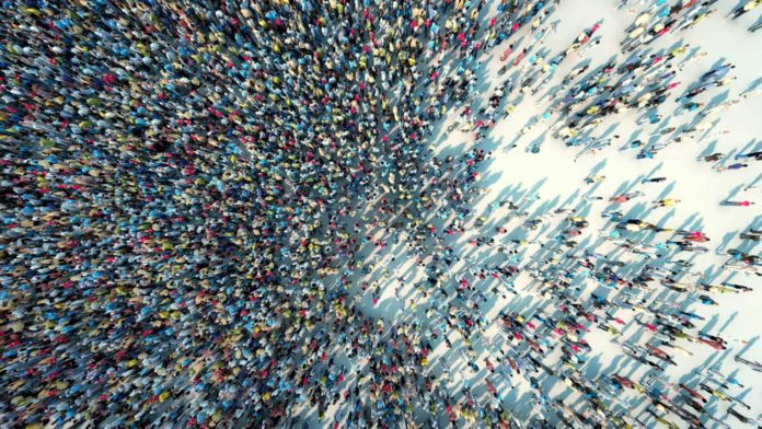 New research shows that particles can move faster when moving from dense crowds toward less crowded areas. IMAGE: ADIMAS/ADOBE STOCK
