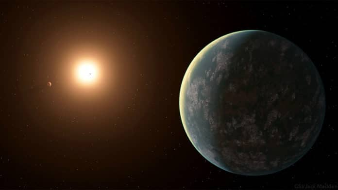 Only 31 light-years away from Earth, the exoplanet GJ 357 d catches light from its host star GJ 357, in this artistic rendering. Credit: Jack Madden/Cornell University