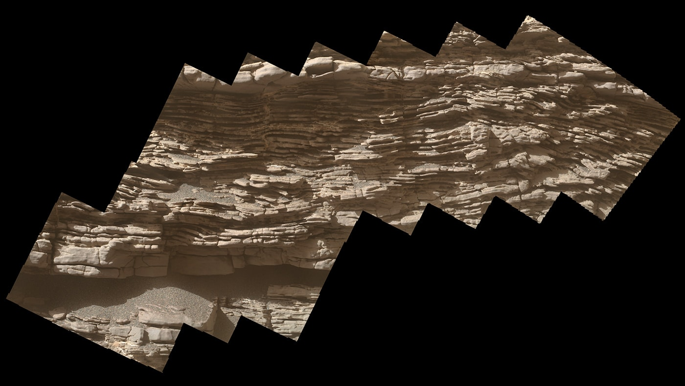 "This mosaic of images shows layers of sediment on a boulder-sized rock called ""Strathdon,"" as seen by the Mars Hand Lens Imager (MAHLI) camera carried by NASA's Curiosity rover. The images were taken on July 10, 2019, the 2,462nd Martian day, or sol, of the mission. Credits: NASA/JPL-Caltech/MSSS"