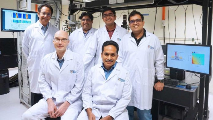 The new quasiparticle named 'polaronic trion' was uncovered by a team led by Prof T. Venky Venkatesan (back row, first from left) from NUSNNI. His team includes (back row, from left) Assoc Prof Shaffique Adam, Dr Soumya Sarkar, Dr Sreetosh Goswami, (seated, from left) Dr Maxim Trushin, Dr Sinu Mathew, as well as six other researchers.