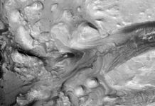 A satellite image of salt deposits on top of Mount Sharp on the surface of Mars. NASA's Curiosity rover is scheduled to explore them in 2020. Courtesy of NASA/JPL/University of Arizona