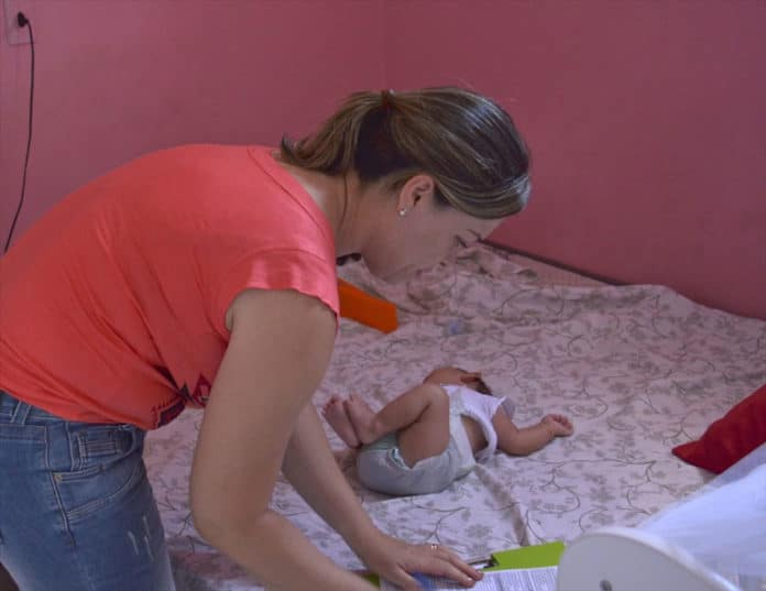 The Zika virus can cause birth defects A nurse evaluates a newborn in Brazil with microcephaly during a home visit. Photo by Michael Greenwood