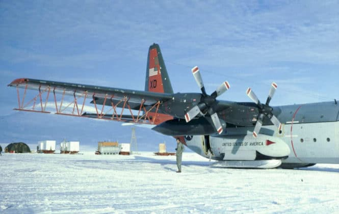 An American military C-130 cargo plane that was converted for Antarctic radar surveys at Williams Field in Antarctica's McMurdo Sound