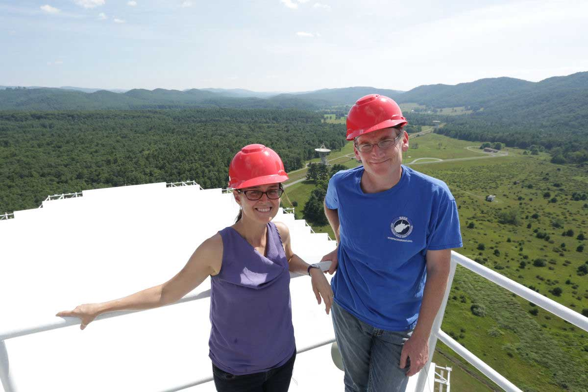 WVU's Maura McLaughlin and Duncan Lorimer use the Green Bank Observatory for research. Here, McLaughlin and Lorimer are standing on top the Green Bank Telescope, which they used to help detect the most massive neutron star ever. CREDIT: Scott Lituchy/West Virginia University.