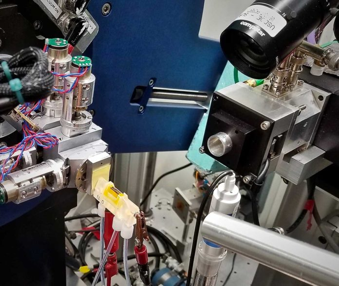 The team's electrochemical cell for observing solar fuel-generating catalysts (yellow device), set up at an x-ray beamline at the Stanford Synchrotron Radiation Lightsource. (Credit: Walter Drisdell/Berkeley Lab)