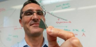 UVM scientist Frederic Sansoz holds a sliver of the world's strongest silver. The new form of metal is part of a discovery that could launch technological advances from lighter airplanes to better solar panels. (Photograph by Joshua Brown)