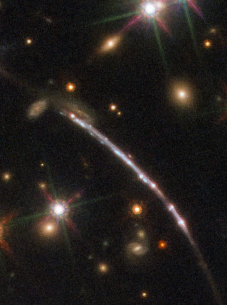 This image, taken with the NASA/ESA Hubble Space Telescope, shows one of four arcs formed of the light from the galaxy nicknamed the Sunburst Arc. Created by strong gravitational lensing, this bright arc of light consists of at least four copies of the image of a single galaxy. The lensed galaxy is about 11 billion light-years away.