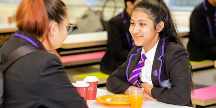 Students from Leeds City Academy enjoying their free breakfast, which is offered to all the academy's students daily, supported by Magic Breakfast. Credit: Ginger Pixie Photography/Magic Breakfast