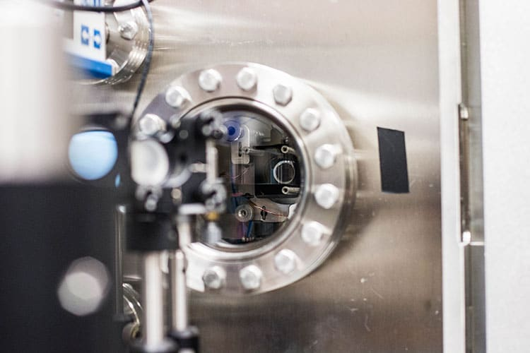 The team used highly sensitive optics to monitor the temperature of the silicon nitride membranes during the experiment. (UC Berkeley photo by Violet Carter)
