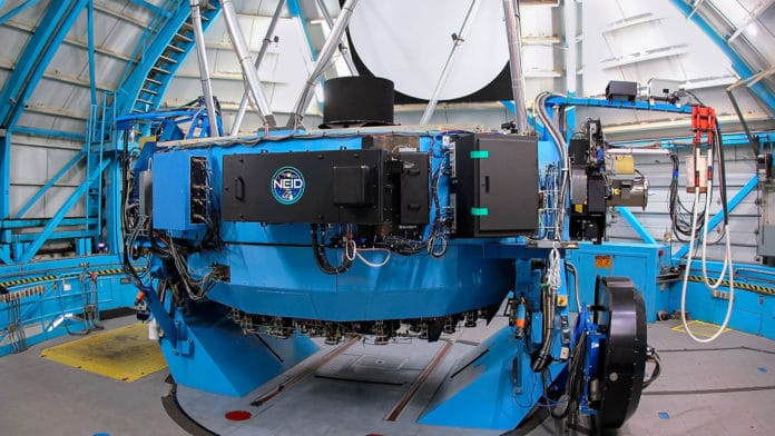 The NEID instrument, mounted on the 3.5-meter WIYN telescope at the Kitt Peak National Observatory. The NASA-NSF Exoplanet Observational Research (NN-EXPLORE) partnership funds NEID (short for NN-EXPLORE Exoplanet Investigations with Doppler spectroscopy).Credit: NSF's National Optical-Infrared Astronomy Research Laboratory/KPNO/NSF/AURA